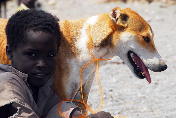 turkana boy with dog